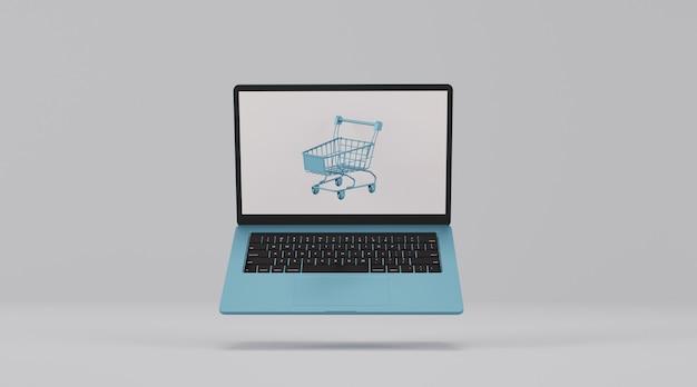 Computer portatile con carrello. concetto di acquisto online.