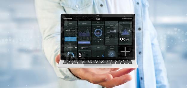 Computer portatile della tenuta dell'uomo d'affari con i dati dell'interfaccia utente di affari sullo schermo isolato
