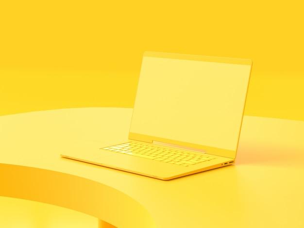 Computer portatile giallo sul tavolo da lavoro