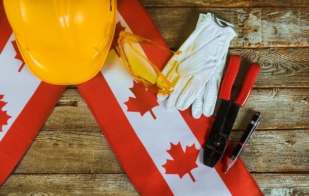 Concetto canadese di vista superiore di festa del lavoro della bandiera di lavoro e di occupazione