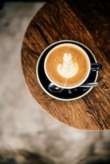 Concetto del cappuccino di latte del ristorante del caffè della caffetteria