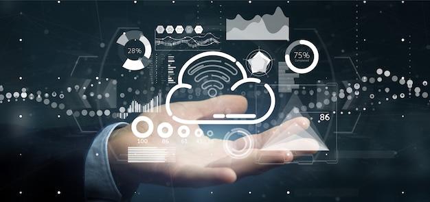 Concetto della nuvola e di wifi della tenuta dell'uomo d'affari con l'icona, le statistiche ed i dati
