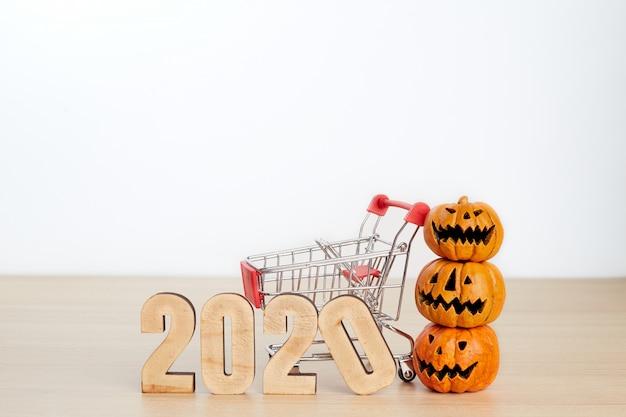 Concetto di acquisto di festival di halloween su bianco