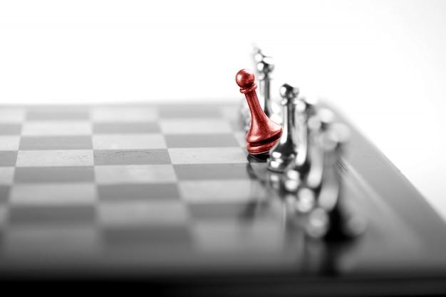 Concetto di affari di scacchi, leader e successo