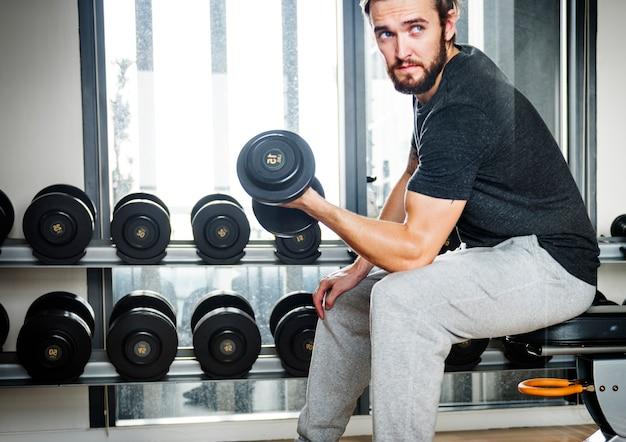 Concetto di forma fisica di esercizio di allenamento di allenamento con i pesi