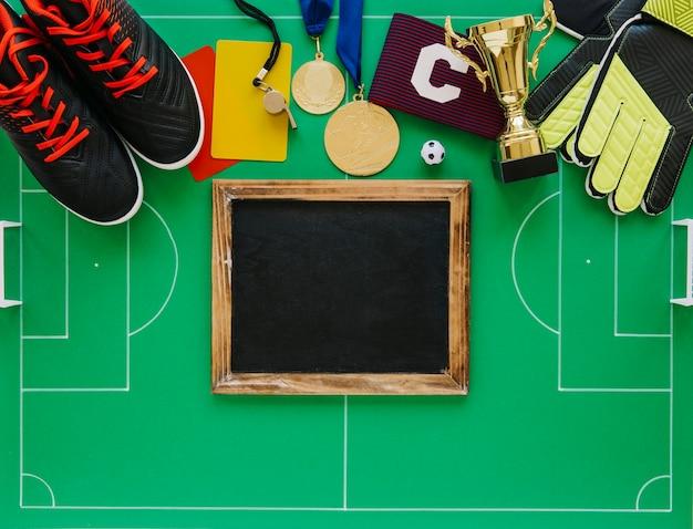 Concetto di gioco del calcio con ardesia
