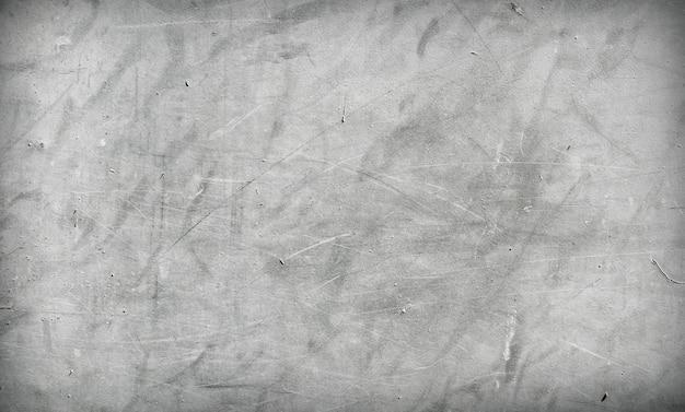 Concetto materiale di struttura del fondo graffiato muro di cemento