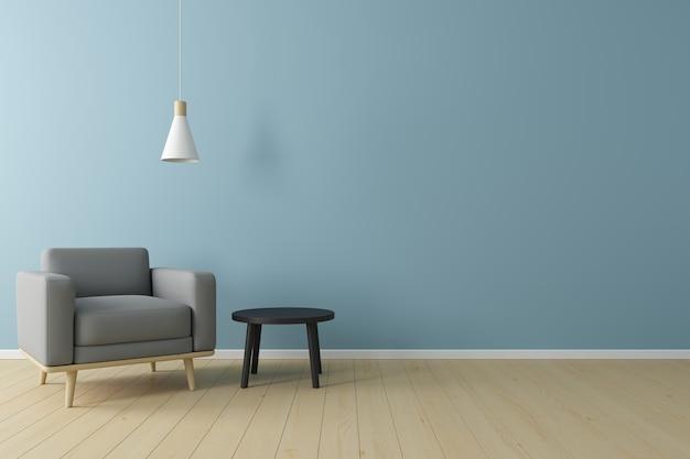 Concetto minimale interno della poltrona in tessuto grigio vivente, lampada da soffitto e tavolo nero sul pavimento in legno e parete blu.