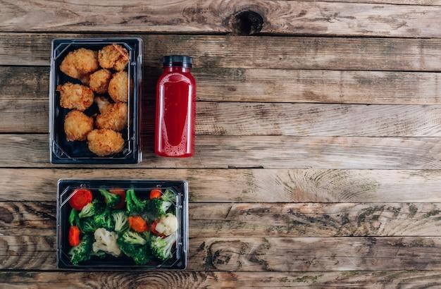 Consegna di cibo sano ristorante in scatole da asporto
