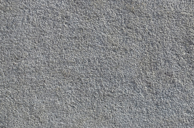 Consistenza del muro di cemento grezzo con texture in rilievo