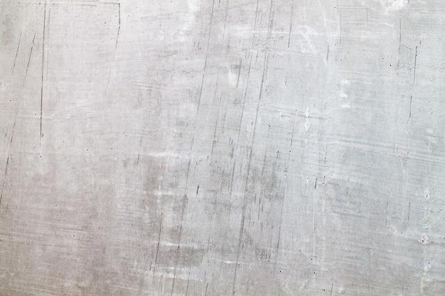 Consistenza del vecchio muro di cemento grigio per lo spazio vuoto copia. per il design e come sfondo