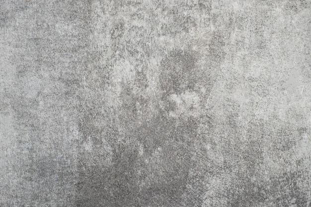 Consistenza del vecchio muro di stucco grigio grigio.