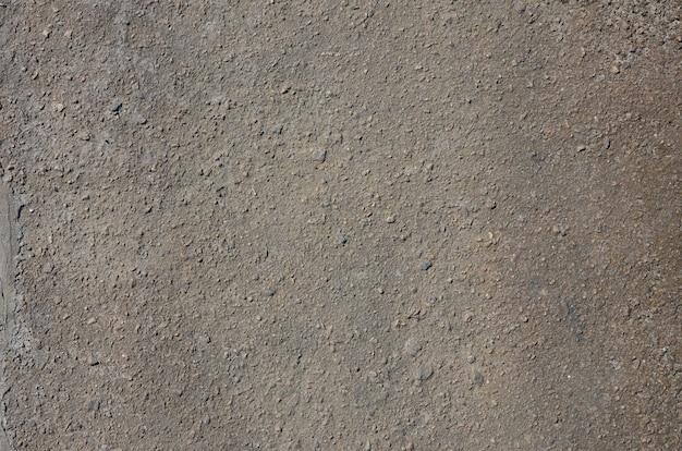 Consistenza dell'asfalto grigio sporco e cupo