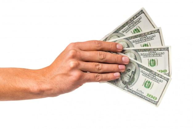 Contanti maschii dei soldi della tenuta della mano isolati