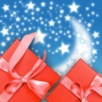 Contenitore di regalo rosso su sfondo di natale