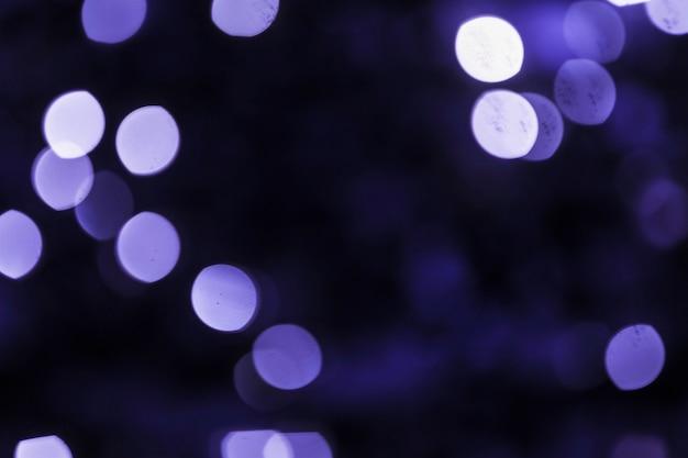 Contesto astratto blu viola del bokeh