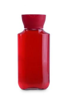 Coperchio rosso, sciampo di igiene cosmetica della bottiglia di plastica del corpo trasparente, condizionatore con idratazione del corpo isolata
