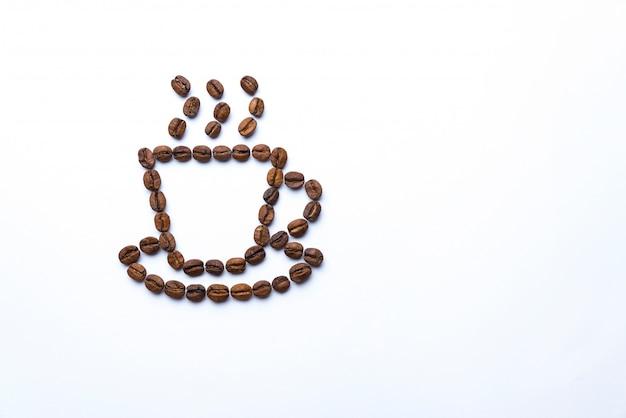 Coppa disegnata con chicchi di caffè
