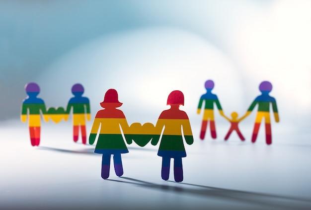 Coppia gay, orgoglio gay, concetto omosessuale bandiera arcobaleno strisce sfondo