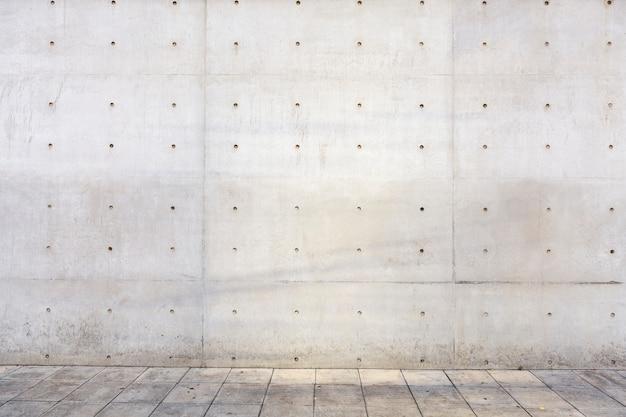 Copyspace della parete del cemento all'aperto del fabbricato industriale