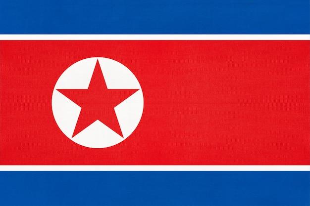 Corea del nord bandiera nazionale tessuto sfondo tessile, simbolo del mondo asiatico paese,