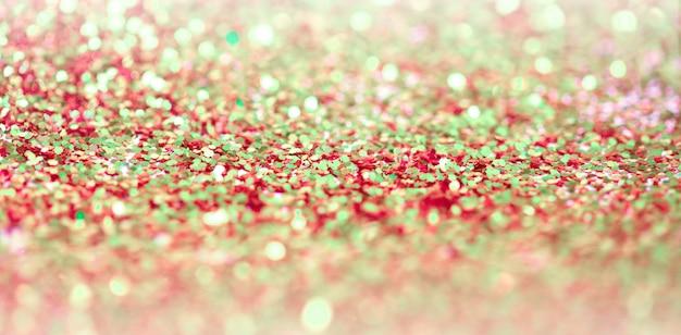 Coriandoli punti glitter brillanti. backgound astratto di defocus della scintilla di lampeggio della sfuocatura della luce.