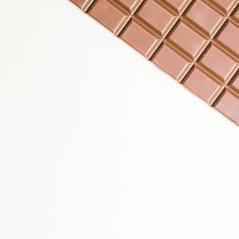 Cornice per alimenti vista dall'alto con cioccolato fondente