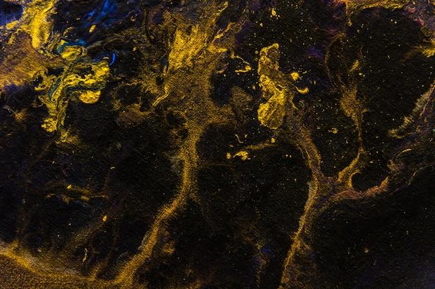 Creativo oro nero astratto dipinto a mano sfondo carta da parati trama design close-up frammento movimento macchie di fluido acrilico pittura ad olio ad olio quadro su tela moderna opera d'arte contemporanea