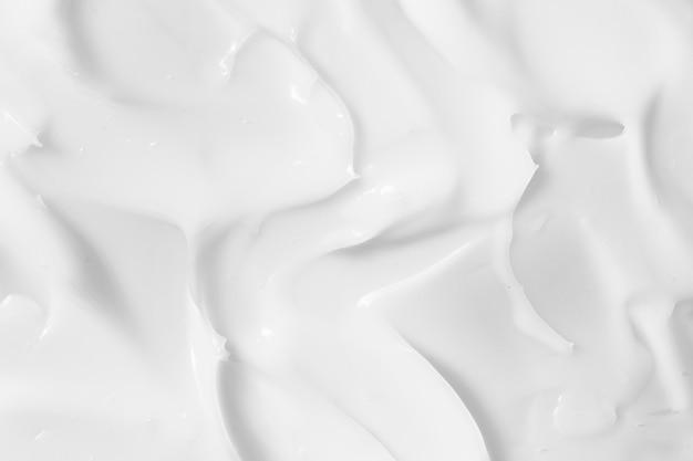 Crema cosmetica bianca, crema idratante, fondo di struttura della lozione
