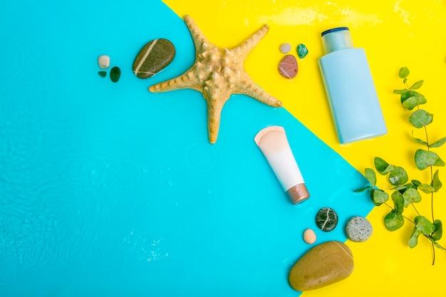 Crema solare crema spf per rimediare alla pelle dal sole con foglie di leucalipto sull'acqua