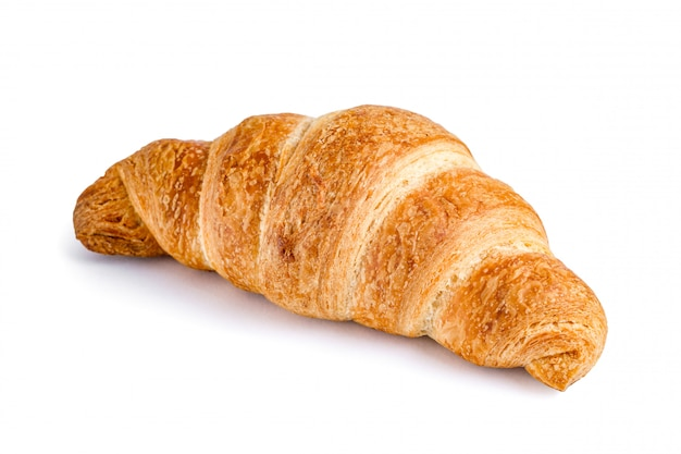 Croissant delizioso e fresco su bianco. cornetto isolato.