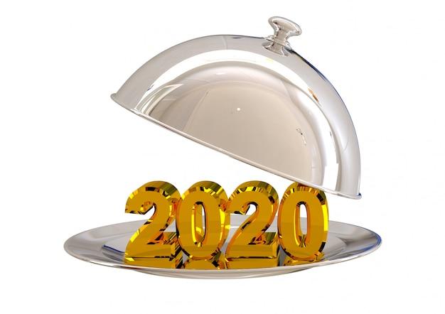 Cromo di cloche aperto con il nuovo anno 2020 sul piatto nel ristorante