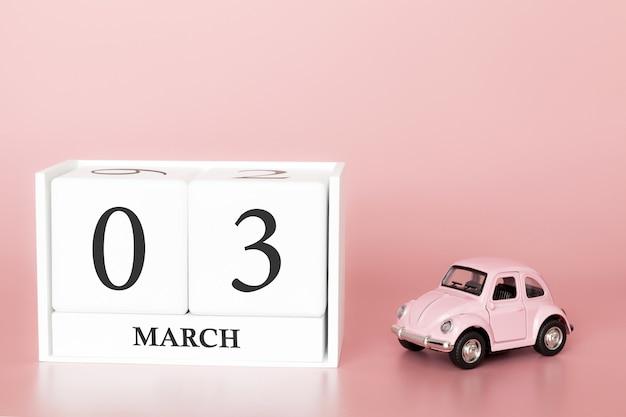 Cubo di legno 3 marzo. giorno 3 del mese di marzo, calendario su uno sfondo rosa con auto retrò.