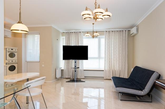 Cucina moderna collegata al soggiorno. interior design con elementi classici o vintage e moderni.