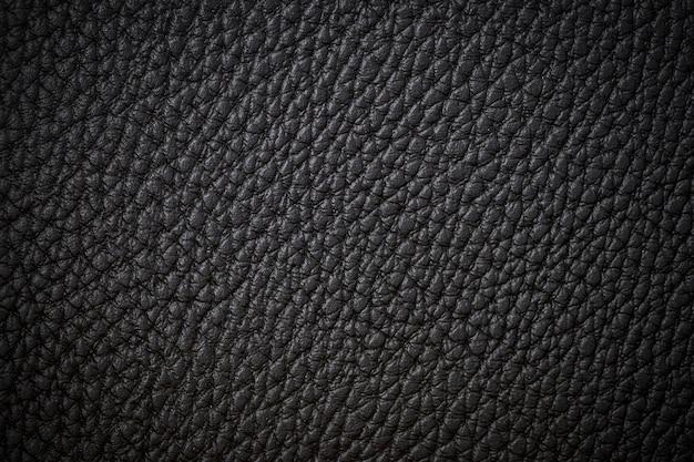 Cuoio scuro del nero di struttura del fondo del primo piano del cuoio nero naturale del primo piano