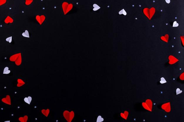 Cuore rosso e cornice cuore bianco