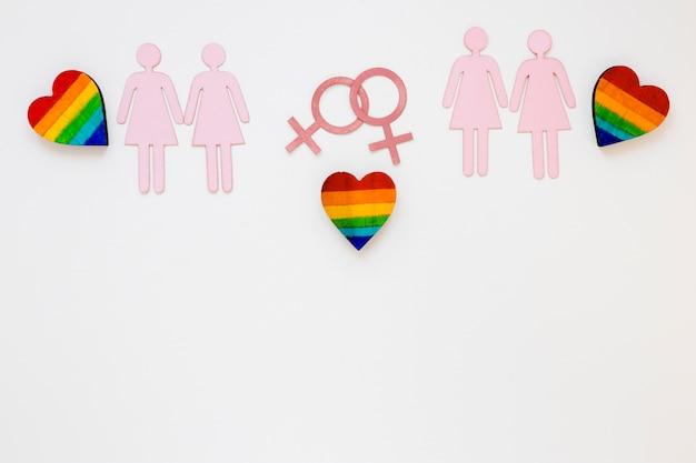 Cuori arcobaleno con icone di coppie lesbiche