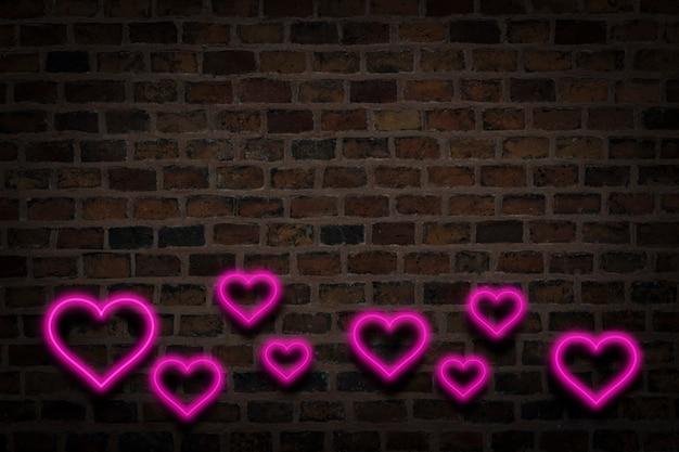 Cuori rosa, insegna al neon sullo sfondo del muro di fuoco. concetto di san valentino, amore.