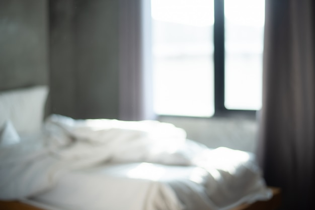 Defocus sfocatura astratta dell'interno camera da letto moderna