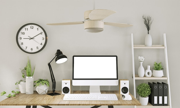 Derida sul computer con lo schermo in bianco e la decorazione nella stanza dell'ufficio derisione su fondo rappresentazione 3d