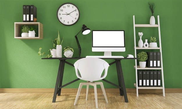 Derida sul computer con lo schermo in bianco e la decorazione nella stanza verde dell'ufficio deridono su fondo rappresentazione 3d
