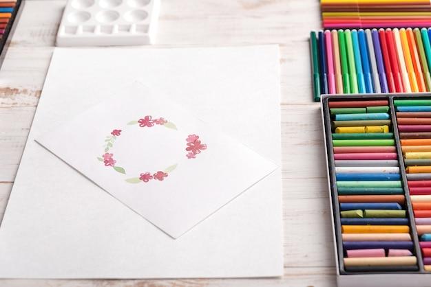 Design della cornice di fiori dipinti con acquerelli su carta
