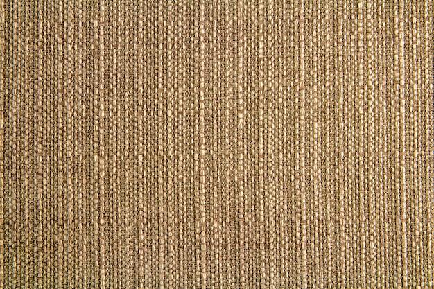 Design in tessuto di lino naturale. tela vestita. sfondo di tela marrone. cotone.
