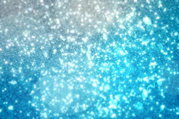 Design luminoso scintillante su blu
