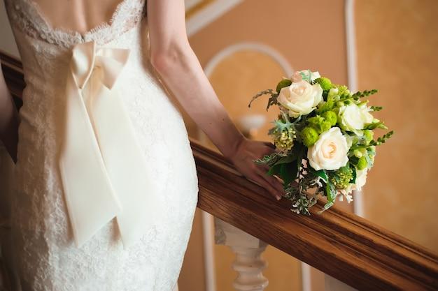 Dettagli del matrimonio sposa, abito bianco da sposa per una moglie