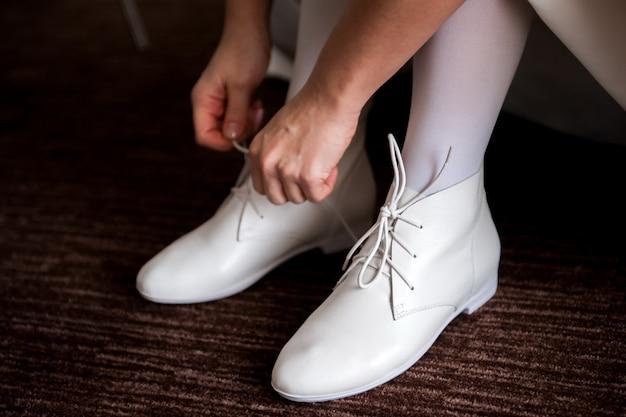 Dettagli di nozze della sposa - scarpe di nozze come backgrond