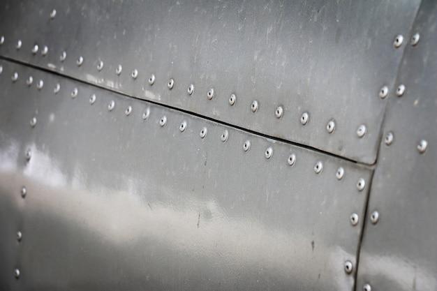 Dettaglio del vecchio pezzo grunge di aeromobili per sfondo metallico