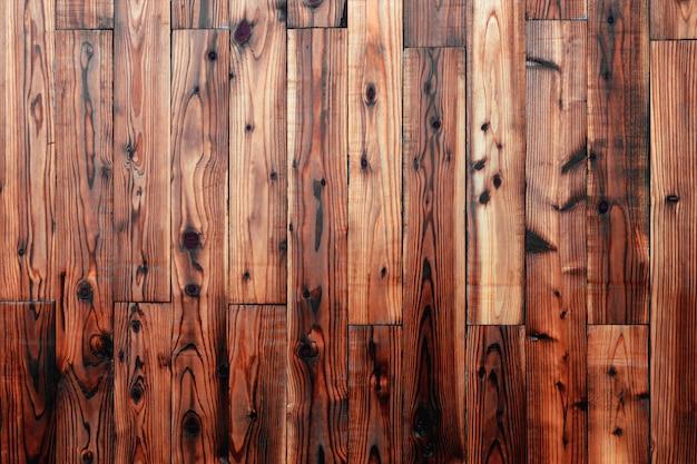Dettaglio della parete del pannello di legno marrone scuro come fondo, modello naturale, venente dall'albero naturale. con spazio vuoto della copia.