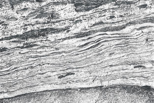 Dettaglio della superficie della pietra della natura del fondo strutturato roccia del granito