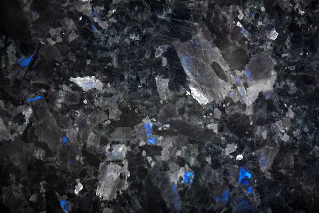 Dettaglio naturale del modello bianco di struttura e fondo di marmo neri per prodotto e interior design. granito nero con cristalli blu
